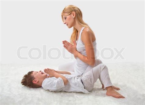 mother  son  yoga  bed stock photo colourbox