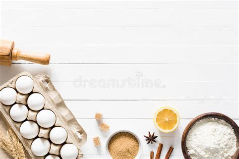 baking ingredients  white wooden table background stock