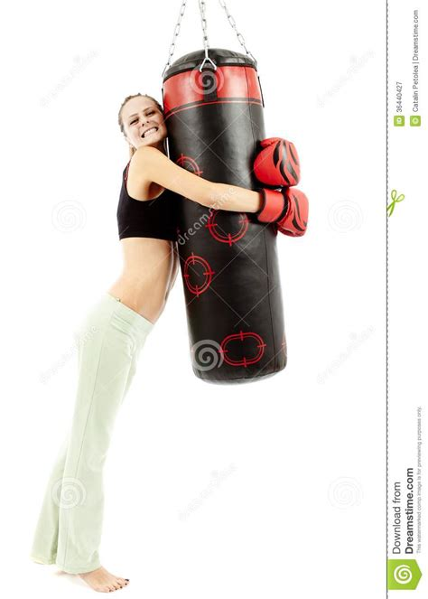 athletic woman hugging  punching bag royalty  stock