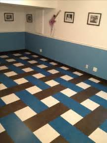 vct vinyl composite tiles in a basket weave pattern it s basement remodel