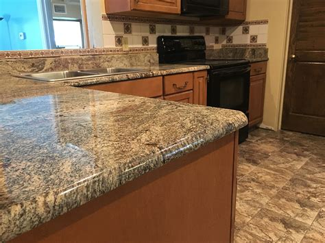 granite countertops with brown cabinets amaretto brown persa granite countertops and cabinets