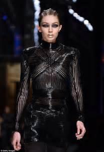 Gigi Hadid wears pink suede jacket at Paris Fashion Week ...