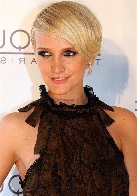 short chic blonde deep side part haircut  bangs