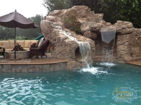swimming pool waterfalls pictures swimming pools with slides and waterfalls 15 rock waterfall with slide splash pools