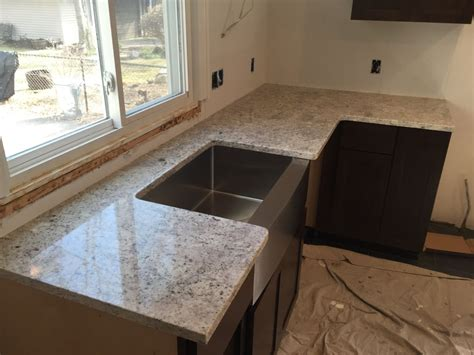salina white granite countertops with farm sink hesano