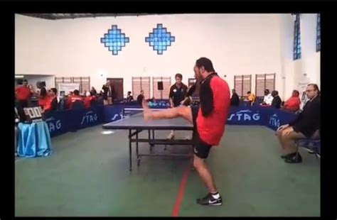 dude   arms plays table tennis   mouth