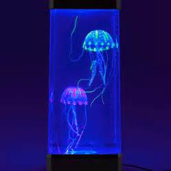 neon jellyfish jelly fish in a tank mood lighting by the