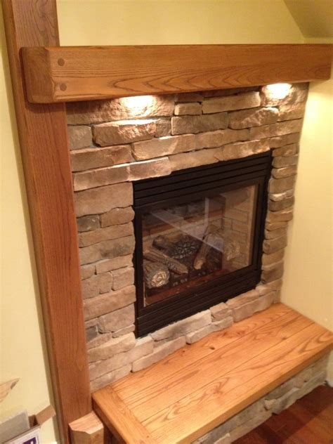 fireplace mantle with undermount lighting