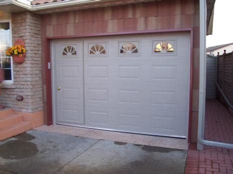 walk through garage door garage door with door non warping patented honeycomb panels and door cores