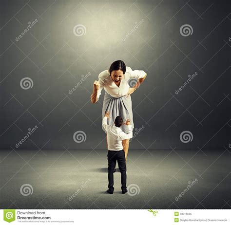 Scared Small Man And Screaming Angry Woman Stock Image
