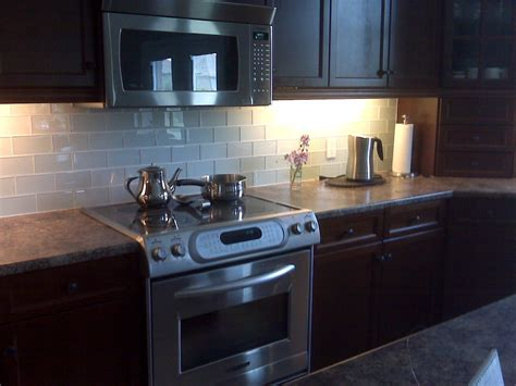 glass subway tile backsplash kitchen modern
