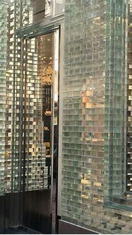 Detail front shop Chanel Amsterdam   bricks glass ...