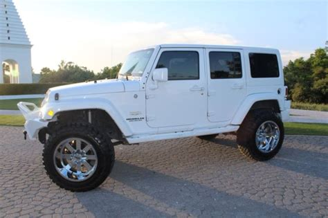 white jeep sahara lifted lifted white jeep chrome wheels great off road bumpers