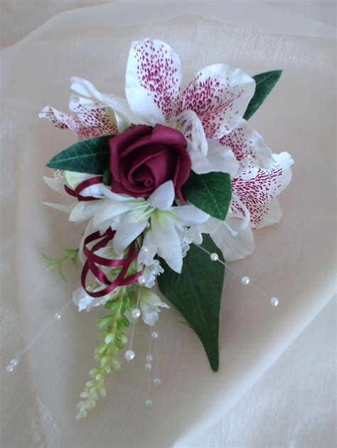 mother   bride corsage  burgundy  ivory