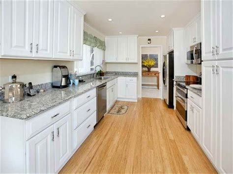 wood floors with white kitchen cabinets light bamboo wood floors with white cabinets bamboo 9839