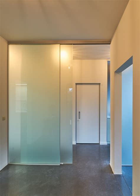 Portes coulissantes en verre sur mesure  Anyway Doors