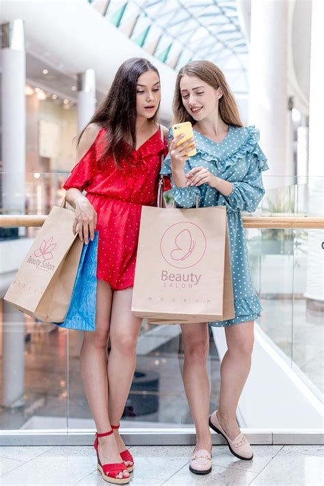 Free shopping bag mockup screenshot 6. Girls Holding Kraft Paper Shopping Bag Mockup Free PSD ...