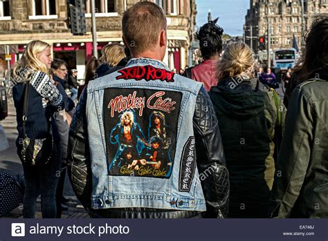 The Back View Of A Young Man Wearing A Black Leather And