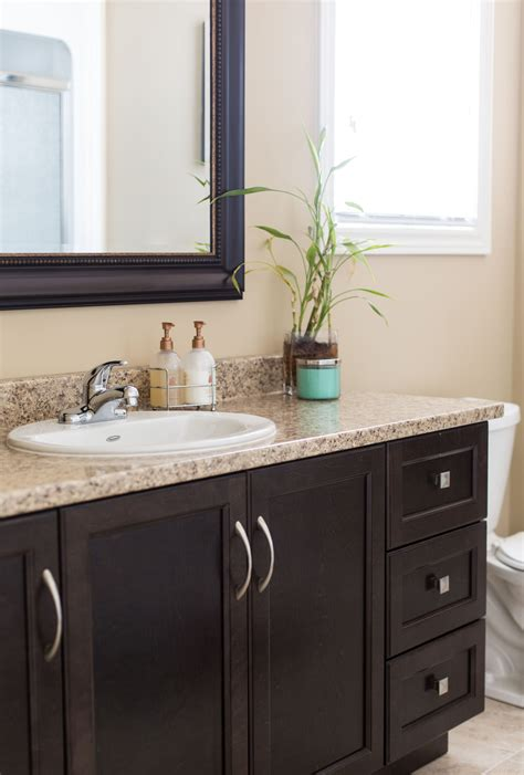 Granite Colors For Bathrooms by Brown Cabinets With A Granite Countertop Beautifully