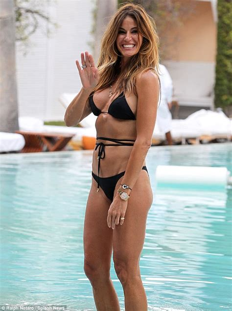paul simon swimsuit kelly bensimon in black string two piece bikini while