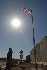 DVIDS - News - Deployed soldiers, firemen raise flags ...