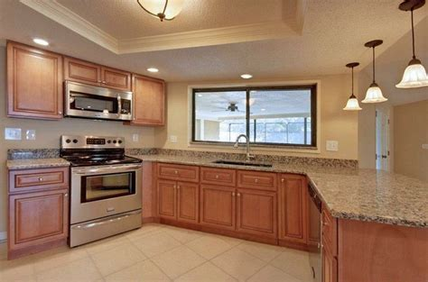 Marquis Cinnamon Kitchen With Stainless Steel Appliances