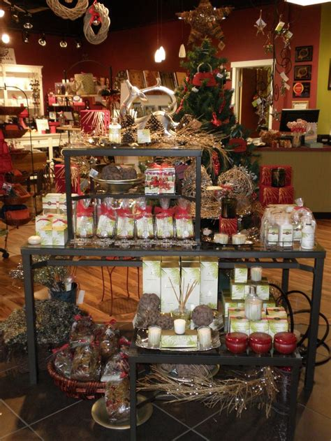 rustic holiday scents and decor table visual merchandising by flourish design merchandising