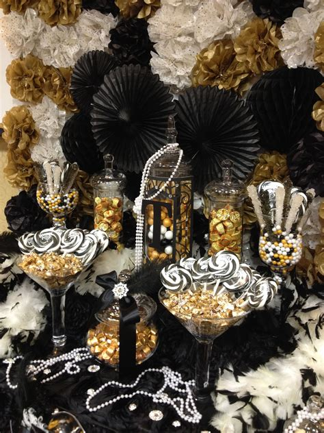 Great Gatsby themed candy buffet gold black and ivory