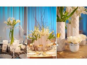 Unique white and blue wedding flower centerpieces | OneWed.com