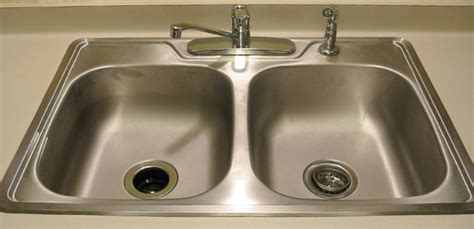 clean  kitchen sink groomed home