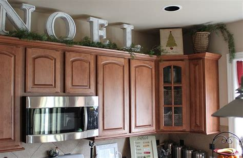how do kitchen cabinets last big letters and pine garland above the kitchen cabinets 8452