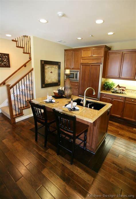 Medium Oak Cabinets With Dark Wood Floors Savaeorg