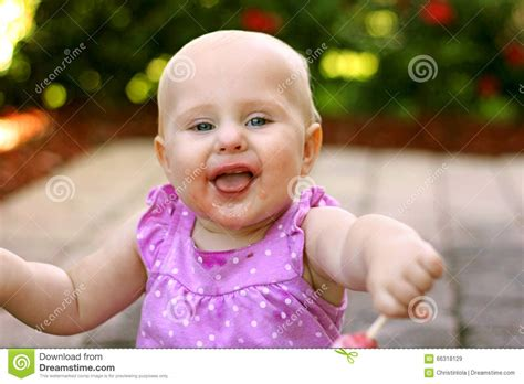 Super Happy Messy Face Baby Girl Outside Stock Photo