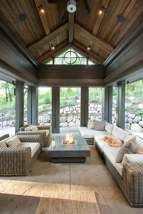 the screened in porch features stained shiplap ceiling and