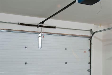 replace  garage door spring    read  bob vila