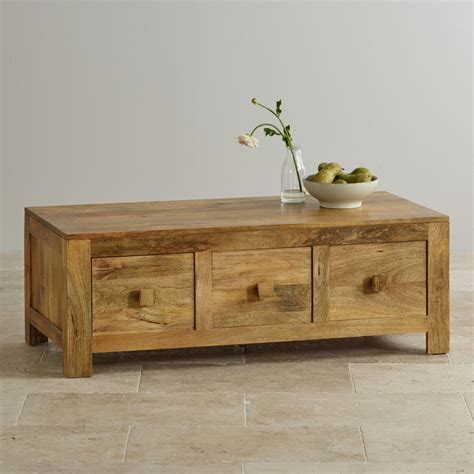 Cleaning the table with a dry dusting cloth is a little tough because the table is a little rough and the cloth can sometimes get caught on a few. Mantis Light Natural Solid Mango 6-Drawer Storage Coffee Table | Coffee table, Oak furniture ...