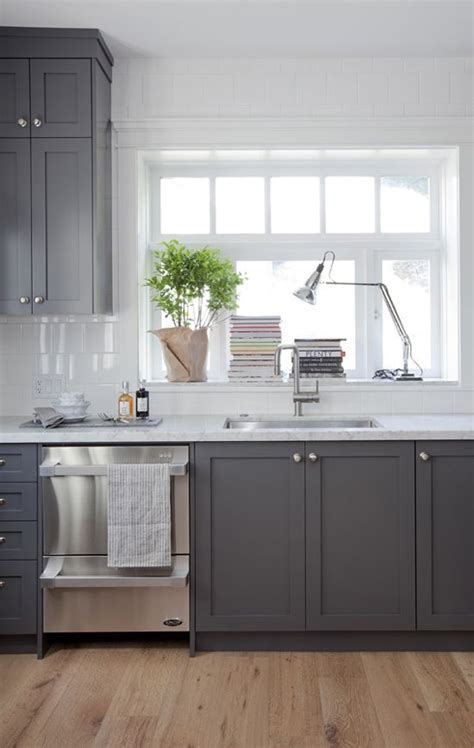 Grey cabinets and white marble counters in a Vancouver