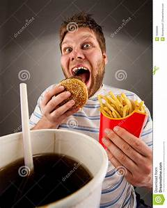 Expressive Man Eating Fast Food Stock Photo - Image: 19390606