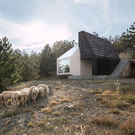 serbian mountain home  exe studio clad   white