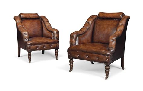 A Pair Of Buttoned And Studded Leather Club Armchairs