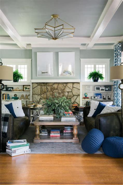 gray transitional family room  stone fireplace hgtv