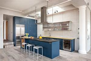 Royal blue kitchen on light color floors is a modern for Kitchen cabinet trends 2018 combined with pop up wall art