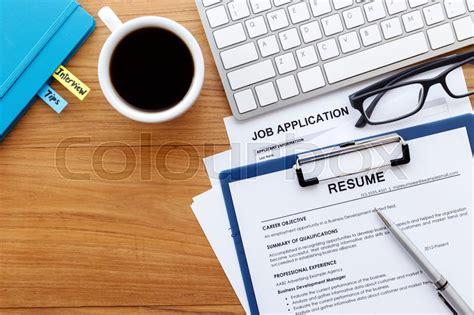 resume  job application  wood desk stock photo