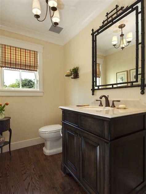 pretty  bath   light fixture  dark wood