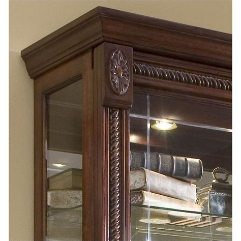 pulaski medallion cherry curio cabinet 20485