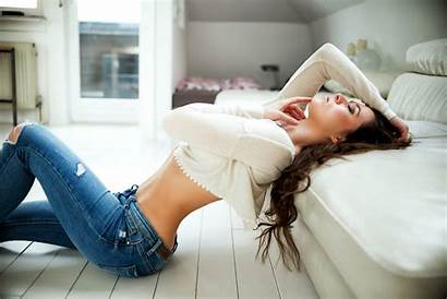 Jeans Sitting Flat Brunette Belly Arched Ass