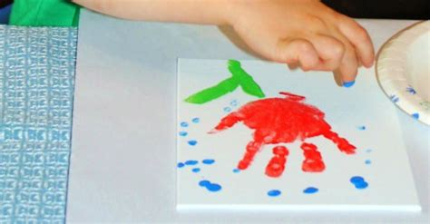 april showers bring  flowers handprint art