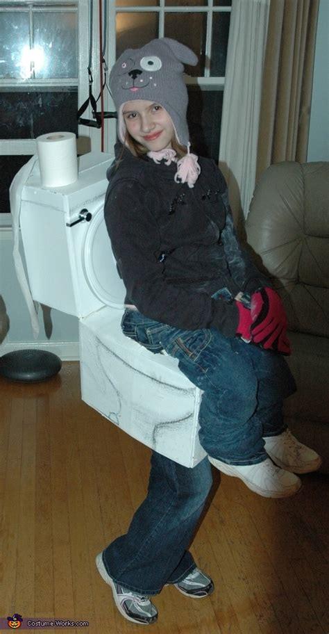girl sitting  toilet costume