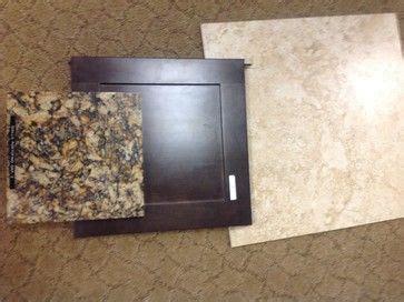 dark espresso cabinets  light tile floors  light