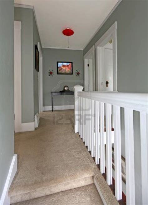 paint ideas for upstairs hallway grey upstairs hallway with white railing and beige carpet